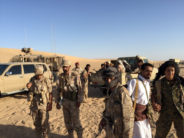 A group of soldiers trained by Emirati and Gulf Arab forces along with Yemeni tribesmen gather near a military base in the Yemeni frontline province of Marib September 14, 2015. (Photo by Noah Browning/Reuters)