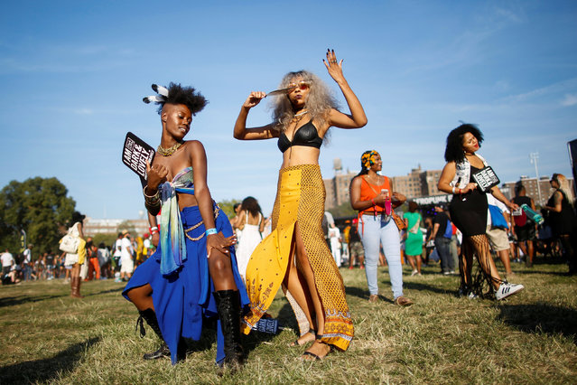 People dance as they take part in the Annual Afropunk Music festival in the borough of Brooklyn in New York, U.S., August 27, 2016. (Photo by Eduardo Munoz/Reuters)