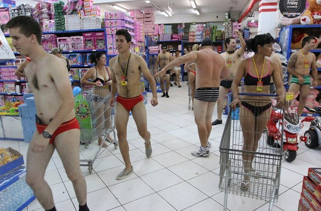Customers in underwear shop during a special promotion at a mall in Ciudad del Este, Paraguay, on December 2, 2012.   AFP PHOTO/ JOSE ESPINOLA        (Photo credit should read JOSE ESPINOLA/AFP/Getty Images)