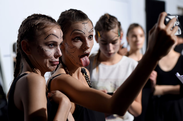 Models  prepare backstage at the DB Berdan show during Mercedes Benz Fashion Week Istanbul SS15 at Antrepo 3 on October 13, 2014 in Istanbul, Turkey. (Photo by Ian Gavan/Getty Images for IMG)