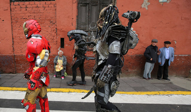 People dressed as in movie costume walk near Saint Rose's Church during celebrations of the anniversary of Santa Rosa de Lima (Saint Rose of Lima), patroness of Latin America and the Philippines, in Lima, Peru, August 30, 2016. (Photo by Mariana Bazo/Reuters)