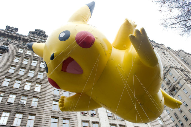 This November 26, 2009 file photo shows the Pikachu Pokemon balloon floating down Central Park West during the Macy's Thanksgiving Day Parade in New York. (Photo by Charles Sykes/AP Photo)