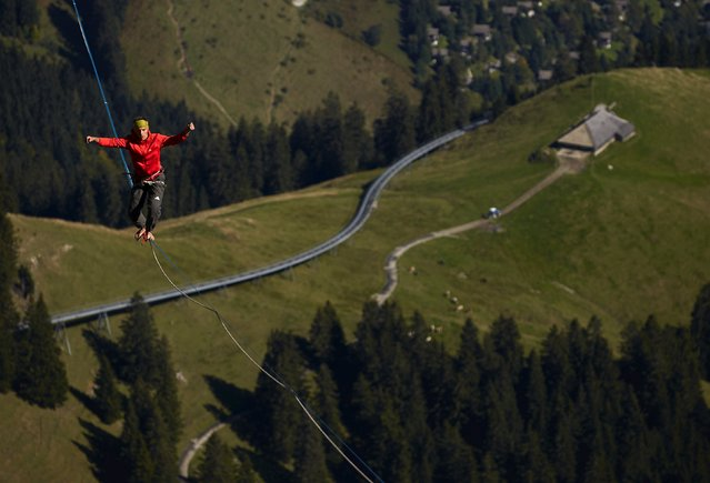 Friedi Kuehni of Germany walks on the line during the Highline Extreme event in Moleson, Switzerland September 25, 2015. (Photo by Denis Balibouse/Reuters)