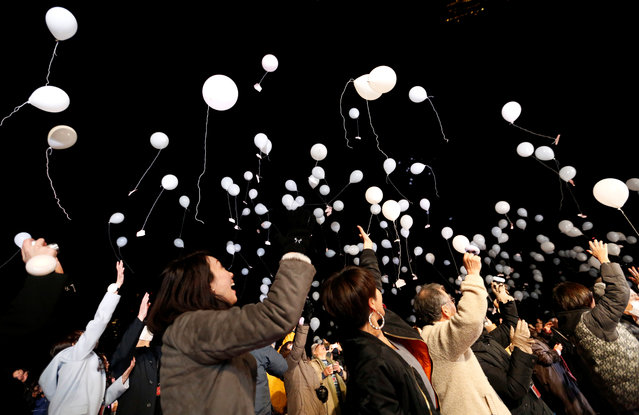 People release balloons as they take part in a New Year countdown event in celebrations to ring in 2018 in Tokyo, Japan January 1, 2018. (Photo by Toru Hanai/Reuters)