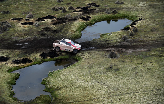 Driver Giniel De Villiers, of South Africa, and co-driver Dirk Von Zitzewitz, of Germany, race their Toyota during stage 7 of the 2018 Dakar Rally between La Paz and Uyuni, Bolivia, Saturday, January 13, 2018. (Photo by Franck Fife/Pool Photo via AP Photo)