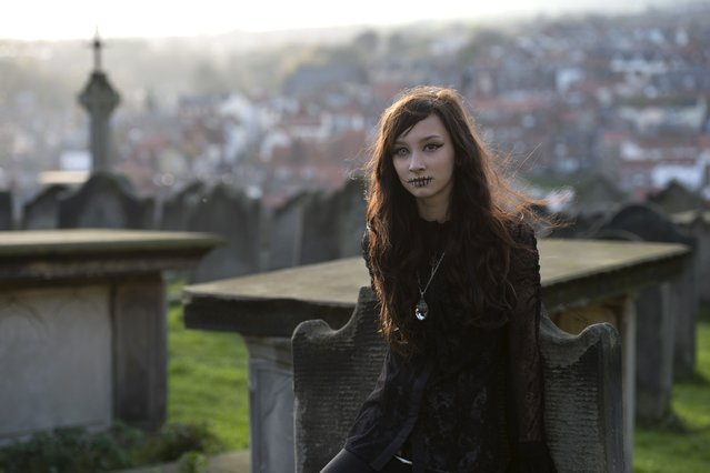 "A girl dressed in a gothic costume is pictured during the biannual ""Whitby Goth Weekend"" (WGW) festival in Whitby, Northern England, on November 2, 2014. (Photo by Oli Scarff/AFP Photo)"