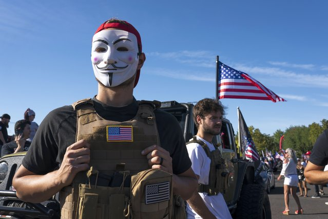 A man who identified himself only as Jonathan wears a Guy Fawkes mask during a rally in support of President Trump on August 29, 2020 in Clackamas, Oregon. Theres obviously an invisible battle going on, he said of his attendance at the rally. Im here to show support for the president and for Q Annon. (Photo by Nathan Howard/Getty Images)