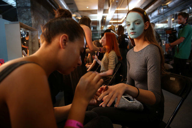 A model is groomed backstage of the Fashion East catwalk show during London Fashion Week Spring/Summer 2017 in London, Britain September 17, 2016. (Photo by Neil Hall/Reuters)