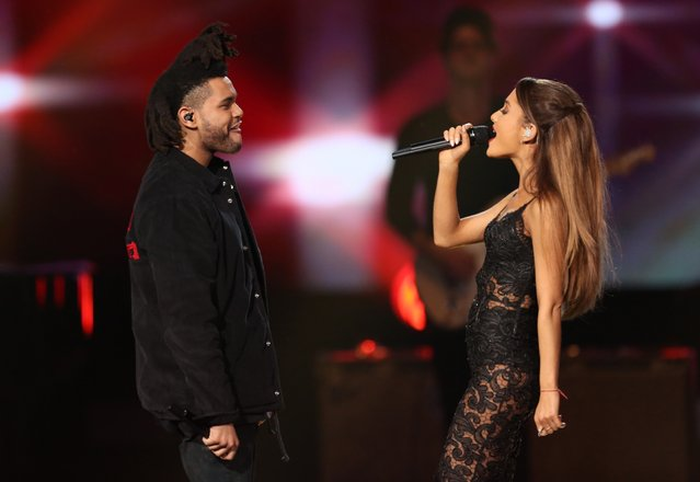 The Weeknd, left, and Ariana Grande perform at the 42nd annual American Music Awards at Nokia Theatre L.A. Live on Sunday, November 23, 2014, in Los Angeles. (Photo by Matt Sayles/Invision/AP Photo)