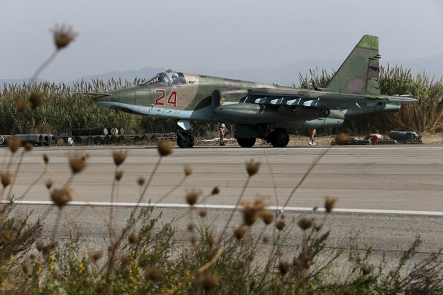 A Sukhoi Su-25 fighter jet is seen on the tarmac at the Hmeymim air base near Latakia, Syria, in this handout photograph released by Russia's Defence Ministry October 22, 2015. (Photo by Reuters/Ministry of Defence of the Russian Federation)