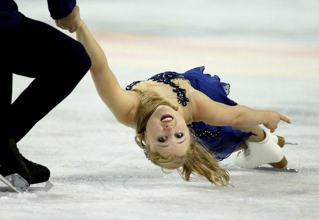 Julianne Seguin of Canada is held by her skating partner and compatriot Charlie Bilodeau during the pairs free skate program at the Skate America figure skating competition in Milwaukee, Wisconsin October 24, 2015. (Photo by Lucy Nicholson/Reuters)