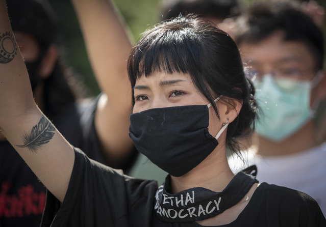 Pro-democracy protesters shout slogans during a protest at the central business district in Bangkok, Thailand, Thursday, October 15, 2020. Thailand's government declared a strict new state of emergency for the capital on Thursday, a day after a student-led protest against the country's traditional establishment saw an extraordinary moment in which demonstrators heckled a royal motorcade. (Photo by Gemunu Amarasinghe/AP Photo)