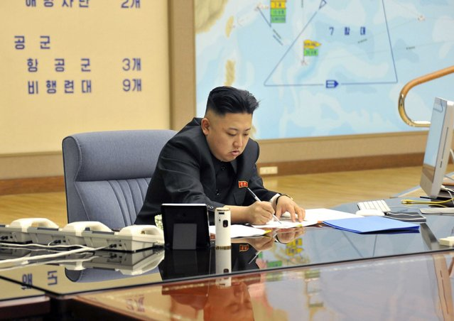 A picture released by the North Korean Central News Agency (KCNA) shows Kim Jong-un convening an urgent operation meeting at 0:30 am on March 29, 2013 at an undisclosed location, in which he ordered strategic rocket forces to be on standby to strike US and South Korean targets at any time. (Photo by KCNA via EPA)