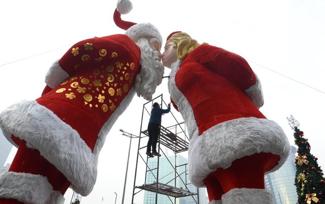 A worker paints Christmas decorations in Taiyuan, Shanxi province, November 29, 2014. (Photo by Jon Woo/Reuters)