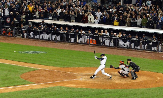 New York Yankees shortstop Derek Jeter (2) hits a walk-off single against the Baltimore Orioles during the ninth inning at Yankee Stadium in New York, in this file picture taken September 25, 2014. (Photo by Brad Penner/Reuters/USA TODAY Sports)