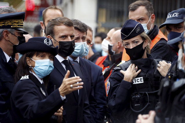 French President Emmanuel Macron, second left, and Nice mayor Christian Estrosi , third left, meet police officers after a knife attack at Notre Dame church in Nice, southern France, Thursday, October 29, 2020. An attacker armed with a knife killed at least three people at a church in the Mediterranean city of Nice, prompting the prime minister to announce that France was raising its security alert status to the highest level. It was the third attack in two months in France amid a growing furor in the Muslim world over caricatures of the Prophet Muhammad that were re-published by the satirical newspaper Charlie Hebdo. (Photo by Eric Gaillard/Pool via AP Photo)