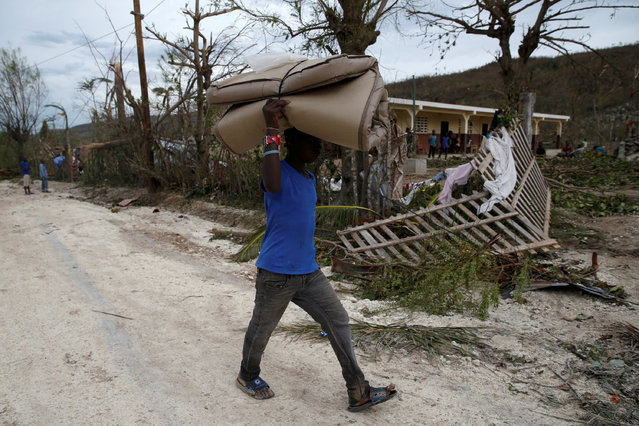 A man carries a mattress down the street after Hurricane Matthew passes Jeremie, Haiti, October 5, 2016. (Photo by Carlos Garcia Rawlins/Reuters)