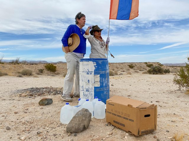 John Hunter, a supporter of U.S. President Donald Trump, and his wife Laura, who doesn't support Trump, put their political differences aside to set up water stations for people illegally crossing the US-Mexico border, in Borrego Springs, California , U.S., October 24, 2020. (Photo by Norma Galeana/Reuters)