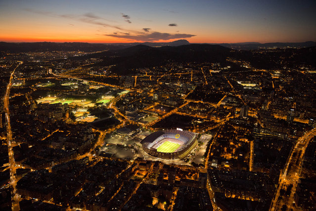 The Camp Nou stadium is illuminated ahead of a soccer match between Barcelona F.C and Eibar in Barcelona, Spain, Tuesday, September 19, 2017. (Photo by Emilio Morenatti/AP Photo)