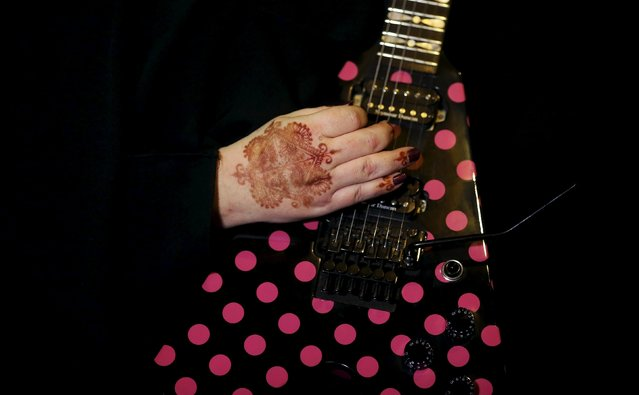 Gisele Marie, a Muslim woman and professional heavy metal musician, plays her Gibson Flying V electric guitar during a fund raising concert for Syrian refugees in Brazil, in Rio de Janeiro November 8, 2015. (Photo by Nacho Doce/Reuters)