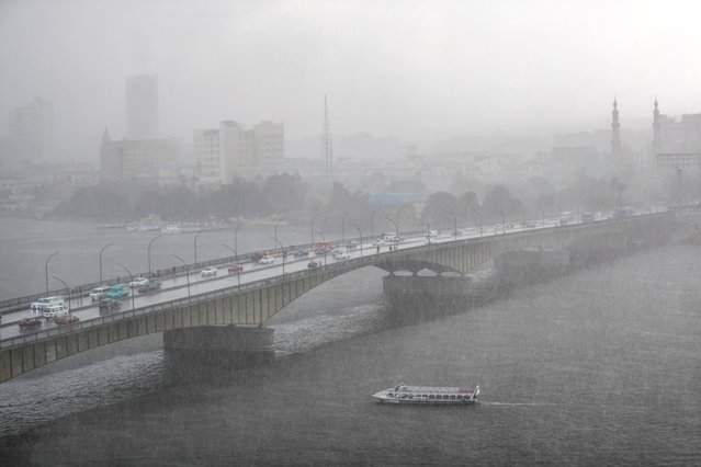 A boat sails on Nile River during heavy rain in the Egyptian capital Cairo on November 25, 2020. (Photo by Khaled Desouki/AFP Photo)