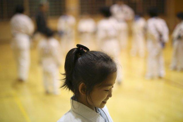 In this November 18, 2015 photo, 9-year-old Mahiro Takano, three-time Japan karate champion in her age group smiles during her karate practice in Nagaoka, Niigata Prefecture, north of Tokyo. (Photo by Eugene Hoshiko/AP Photo)