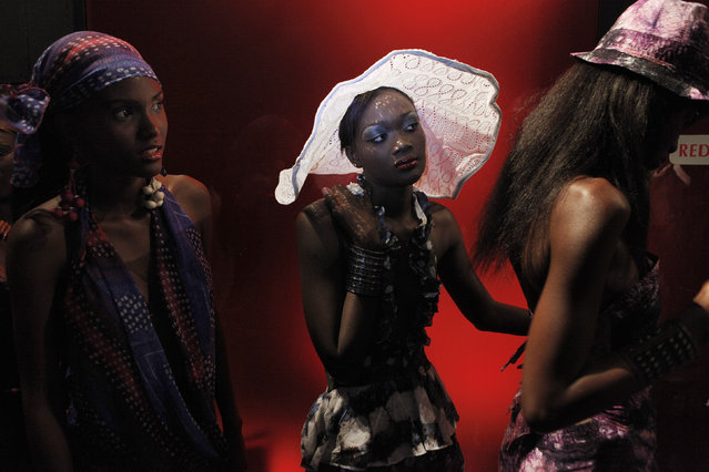 Model Sachakara Dieng wears a creation by Senegalese designer Fallou Style during Dakar Fashion Week in Senegal's capital, July 7, 2011. (Photo by Finbarr O'Reilly/Reuters)