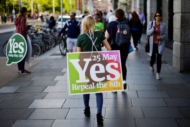 "Activists from the ""Yes"" campaign, urging people to vote ""yes"" in the referendum to repeal the eighth amendment of the Irish constitution, canvas voeters in Dublin on May 24, 2018. Ireland will hold a referendum on May 25 on whether to alter its constitution to legalise abortion. The Eighth Amendment of the Irish constitution recognises the equal right to life of the unborn and the mother. Abortion is illegal unless there is a real and substantial risk to the life of the mother, and a woman convicted of having an illegal termination faces 14 years imprisonment. (Photo by Max Rossi/Reuters)"