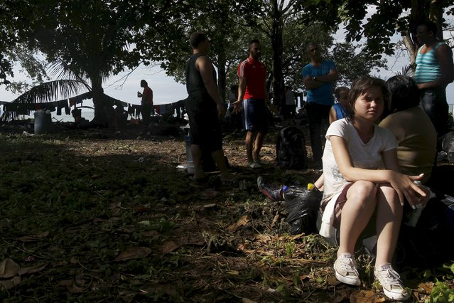 A Cuban migrant rests after arriving safely in La Miel in the province of Guna Yala in Panama, having crossed the border from Colombia through the jungle, November 28, 2015. (Photo by Carlos Jasso/Reuters)