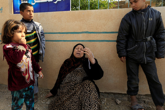 A mother, who just fled fighting between Iraqi army and Islamic State in the Intisar district of eastern Mosul, reacts after her son was detained and accused of being an Islamic State fighter in Iraq, November 7, 2016. (Photo by Zohra Bensemra/Reuters)