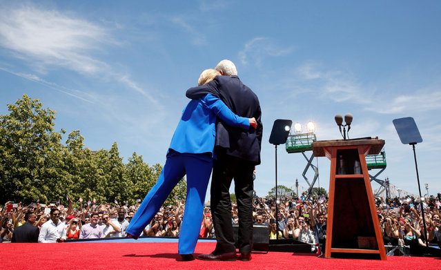 """U.S. Democratic presidential candidate Hillary Clinton is embraced by her husband former President Bill Clinton (R)  after she delivered her """"official launch speech"""" at a campaign kick off rally in Franklin D. Roosevelt Four Freedoms Park on Roosevelt Island in New York City, June 13, 2015. (Photo by Lucas Jackson/Reuters)"""