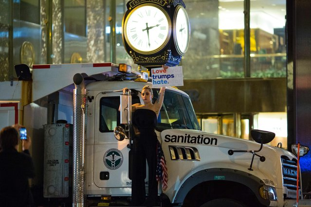 Musician Lagy Gaga stages a protest against Republican presidential nominee Donald Trump on a sanitation truck outside Trump Tower in New York City after midnight on election day November 9, 2016. Donald Trump stunned America and the world, riding a wave of populist resentment to defeat Hillary Clinton in the race to become the 45th president of the United States. The Republican mogul defeated his Democratic rival, plunging global markets into turmoil and casting the long-standing global political order, which hinges on Washington's leadership, into doubt. (Photo by Dominick Reuter/AFP Photo)