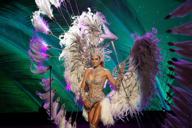 Miss Argentina, Valentina Ferrer, poses for the judges, during the national costume show during the 63rd annual Miss Universe Competition in Miami, Fla., Wednesday, January 21, 2015. (Photo by J. Pat Carter/AP Photo)