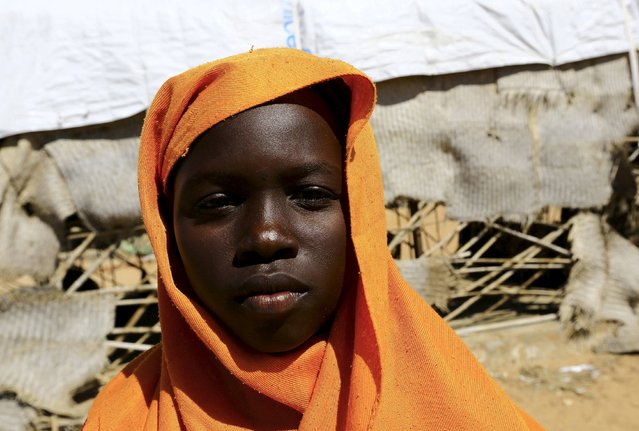 Mona Abdallah  Fath Al- Jaleel, a 5th grader at the Kalma camp for the internally displaced poses for a photograph in Nyala, South Darfur in Sudan, November 22, 2015. Born in the camp, 12 years old Al-Jaleel wishes to be a doctor in her adulthood. (Photo by Mohamed Nureldin Abdallah/Reuters)