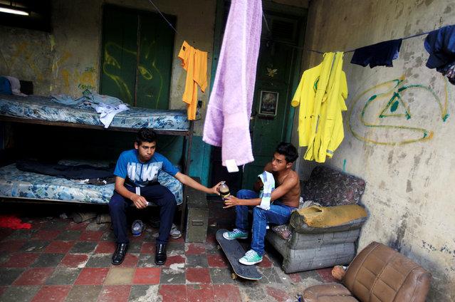 Rescuers Joel Altamirano (L) and Cesar Munoz share a soda at the Comandos de Salvamento base in San Salvador, El Salvador August 10, 2016. (Photo by Jose Cabezas/Reuters)