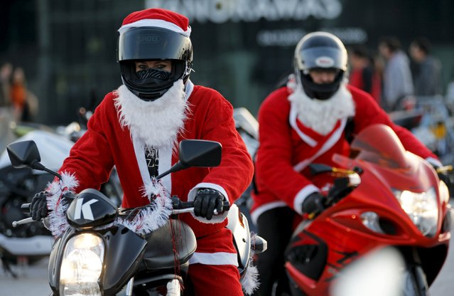 Bikers dressed as Santa Claus take part in a charity ride to bring gifts to hospitalized children in Marseille, France, December 20, 2015. (Photo by Jean-Paul Pelissier/Reuters)