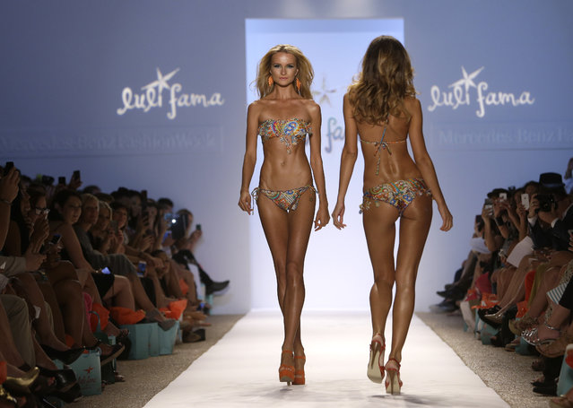 Models walks the runway during the Luli Fama show at Mercedes-Benz Fashion Week Swim, Sunday, July 21, 2013, in Miami Beach, Fla. (Photo by Lynne Sladky/AP Photo)