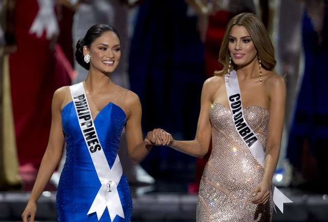Miss Philippines Pia Alonzo Wurtzbach (L) waits with Miss Colombia Ariadna Gutierrez before Miss Colombia was initially announced as Miss Universe during the 2015 Miss Universe Pageant in Las Vegas, Nevada, December 20, 2015. Host Steve Harvey said he made a mistake when reading the card and Miss Philippines Pia Alonzo Wurtzbach was the actual winner. (Photo by Steve Marcus/Reuters)