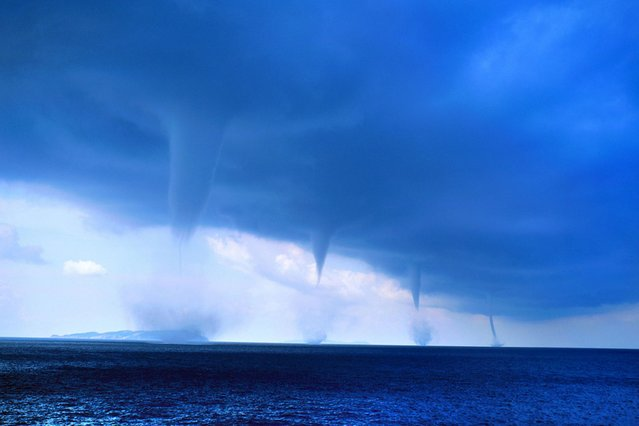 Photographer Roberto Giudici snapped this picture of four waterspouts as he was sailing off the Greek island of Orthoni, on August 3, 2013. (Photo by Roberto Giudici/Caters News)