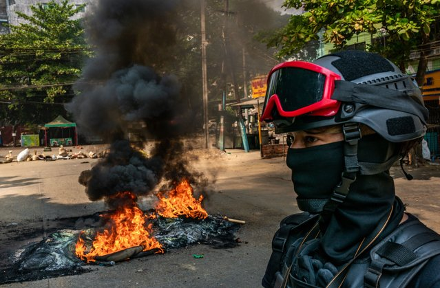 Protesters set fire to tires on a road to slow the progress of security forces on March 27, 2021 in Yangon, Myanmar. Myanmar's military Junta continued a brutal crackdown on a nationwide civil disobedience movement in which thousands of people have turned out in continued defiance of live ammunition. Local news sources and witnesses said over 90 protesters were killed on Saturday, the deadliest day of clashes since protests against the coup began. (Photo by Stringer/Getty Images)