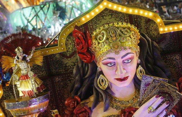 A reveller from the Grande Rio samba school participates in the annual carnival parade in Rio de Janeiro's Sambadrome, February 16, 2015. (Photo by Ricardo Moraes/Reuters)