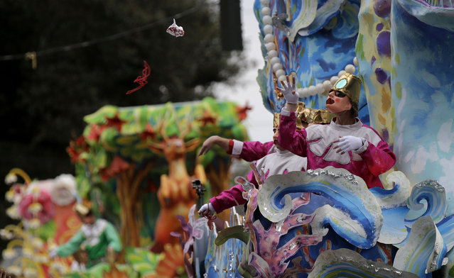 A float rider throws beads from his float during the Krewe of Proteus Mardi Gras parade in New Orleans, Monday, February 16, 2015. (Photo by Gerald Herbert/AP Photo)