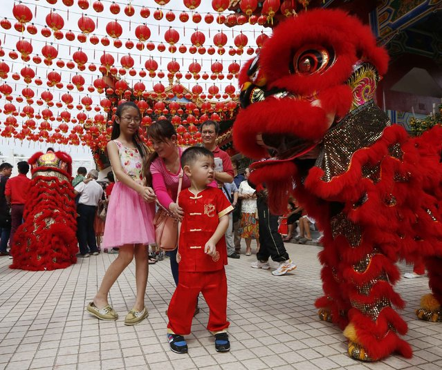 A boy reacts to a lion dancer on Chinese New Year at the Thean Hou temple in Kuala Lumpur, February 19, 2015. (Photo by Olivia Harris/Reuters)