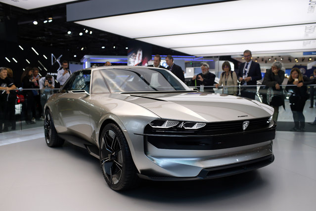 The Peugeot e-legend is on display at the Auto show in Paris, France, Tuesday, October 2, 2018, 2018. All-electric vehicles with zero local emissions are among the stars of the Paris auto show, rubbing shoulders with the fossil-fuel burning SUVs that many car buyers love. (Photo by Thibault Camus/AP Photo)