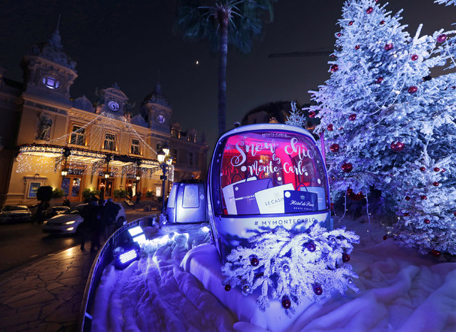 Christmas trees are seen by the Monte Carlo Casino as part of holiday season decorations in Monaco, December 6, 2016. (Photo by Eric Gaillard/Reuters)