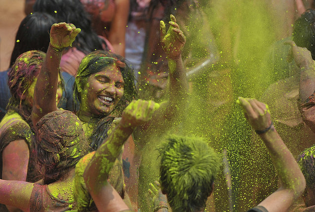 Indian revellers dance as during Holi celebrations in Hyderabad on March 5, 2015. Holi, also called the Festival of Colours, is a popular Hindu spring festival observed in India at the end of the winter season on the last full moon day of the lunar month. AFP PHOTO / Noah SEELAM        (Photo credit should read NOAH SEELAM/AFP/Getty Images)