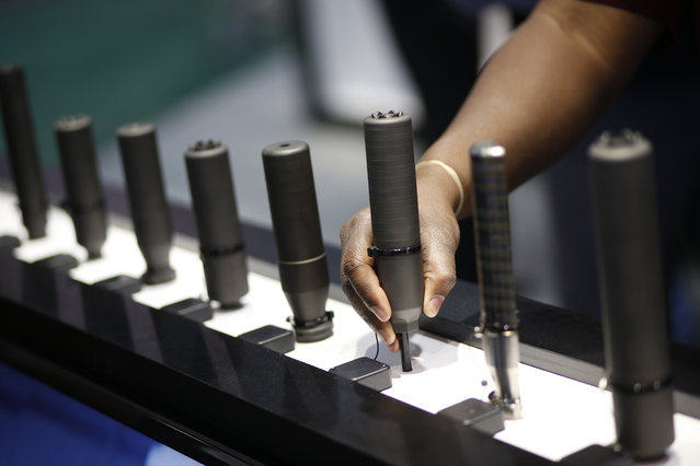 Silencers are on display at the Sig Sauer booth at the Shooting, Hunting and Outdoor Trade Show, Tuesday, January 19, 2016, in Las Vegas. (Photo by John Locher/AP Photo)