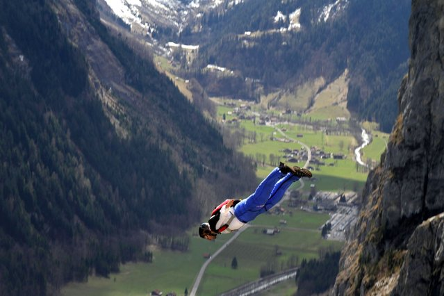 Daredevils took part in the jump from Mushroom Cliff on the north face of the Eiger in Switzerland as part of a base jumping class, on Oktober 16, 2013. (Photo by Caters News)