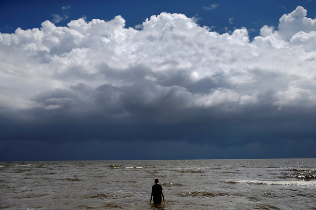 15-year-old Jordan Carambat wades in the ocean as Tropical Storm Gordon approaches Waveland, Mississippi, U.S., September 4, 2018. (Photo by Jonathan Bachman/Reuters)
