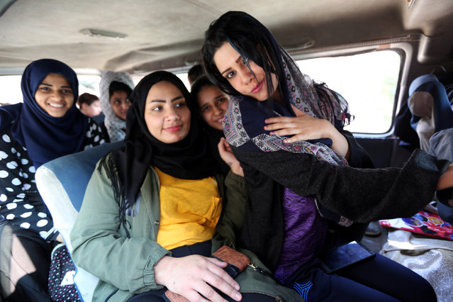 "Iraqi women sit on the bus as they leave the gym after exercises in Diwaniya, Iraq on November 10, 2018. ""A woman wrestling is alien to our conservative tribal society"", she said. ""The idea is hard to accept. It was so difficult to attract girls and convince their families. I was threatened myself by a brother of a player who verbally abused me and tried to hit me. It is so difficult to bring them to training and return them to their houses"". (Photo by Alaa Al-Marjani/Reuters)"
